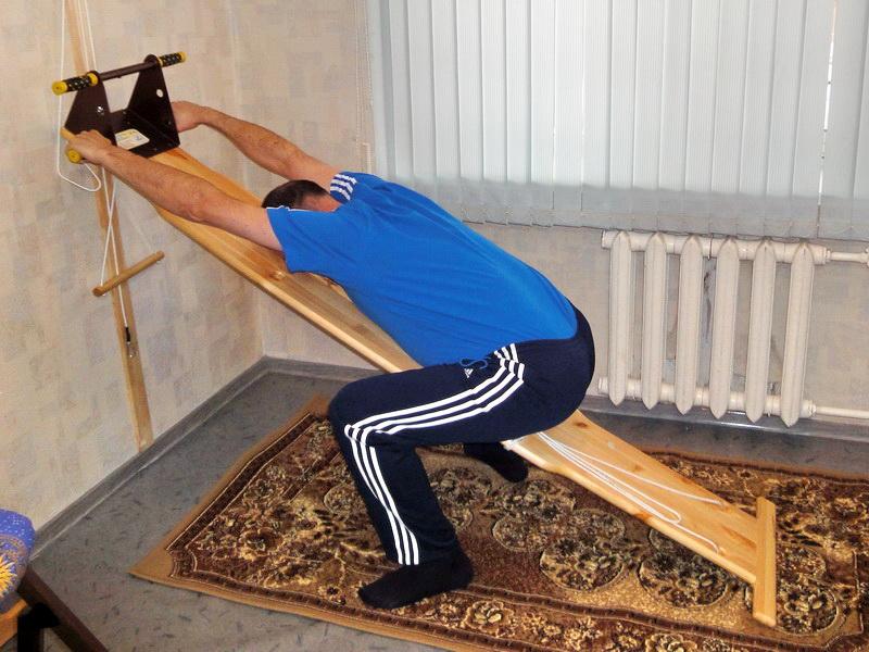 Вытяжка позвоночника в домашних условиях, упражнения для